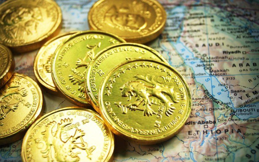 Guldpengar på en karta